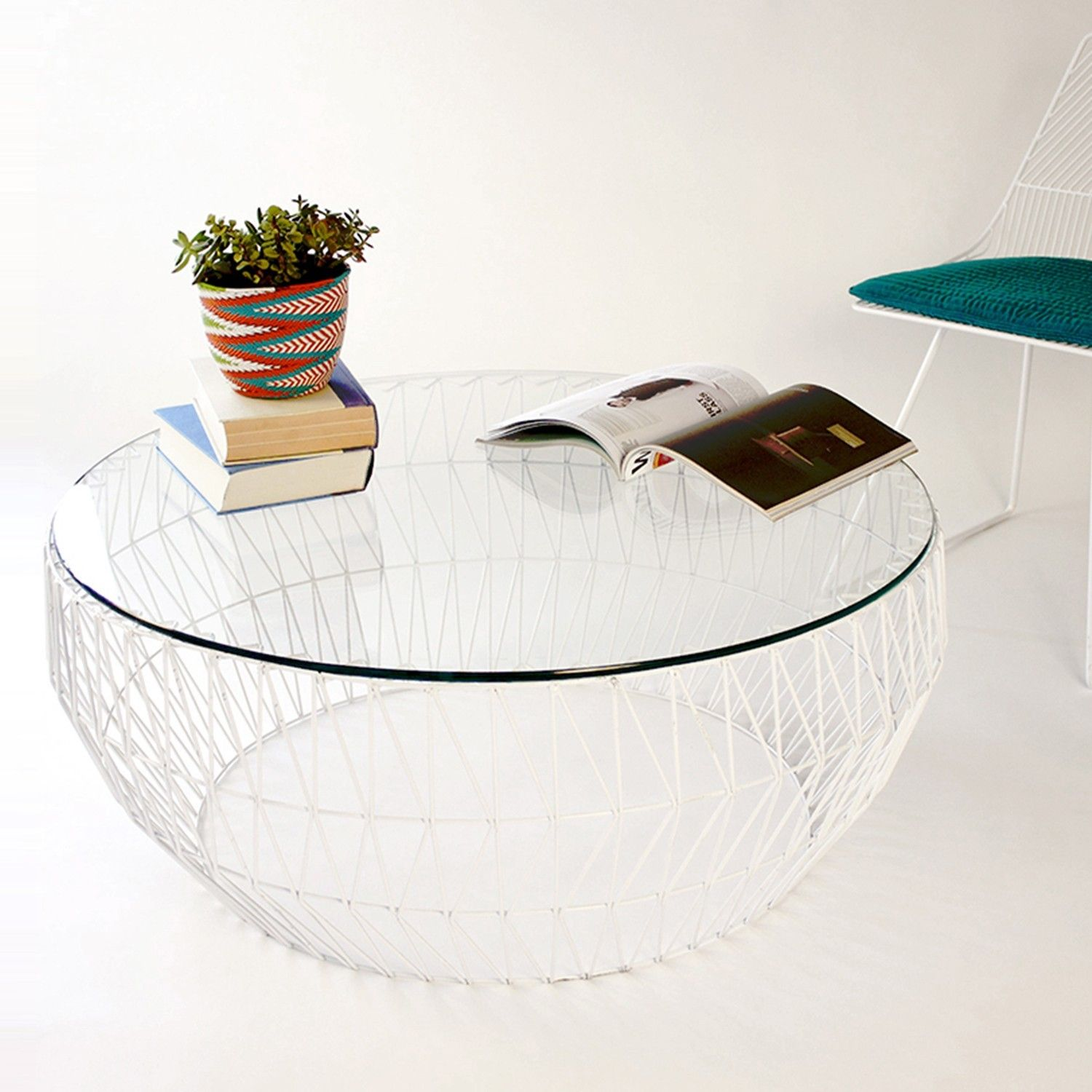 The Bend Goods Glass Coffee Table is modern with an airy design. http://www.yliving.com/blog/outdoor-furniture-trend-metal/