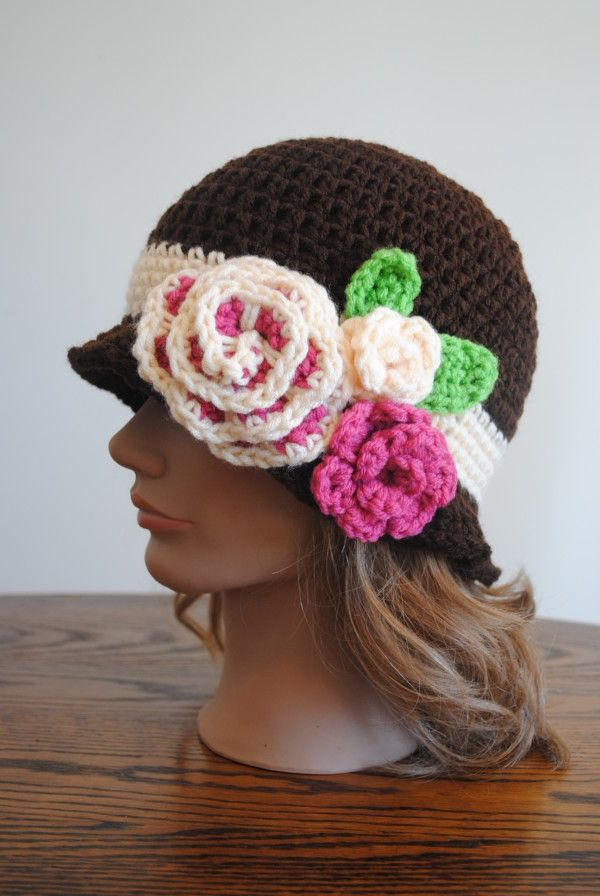 Free Spring Crochet Pattern- Red Heart Spring Blossom Cloche.  Some really good tutorials on sizing hats and invisible seams.