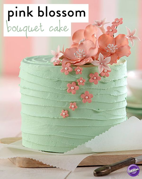 Wow Mom with this elegant cake for Mother's Day that features a lovely floral topper. Use the Wilton Gum Paste Flower Cutter Set to craft these delicate flowers with ready-to-use Gum Paste.
