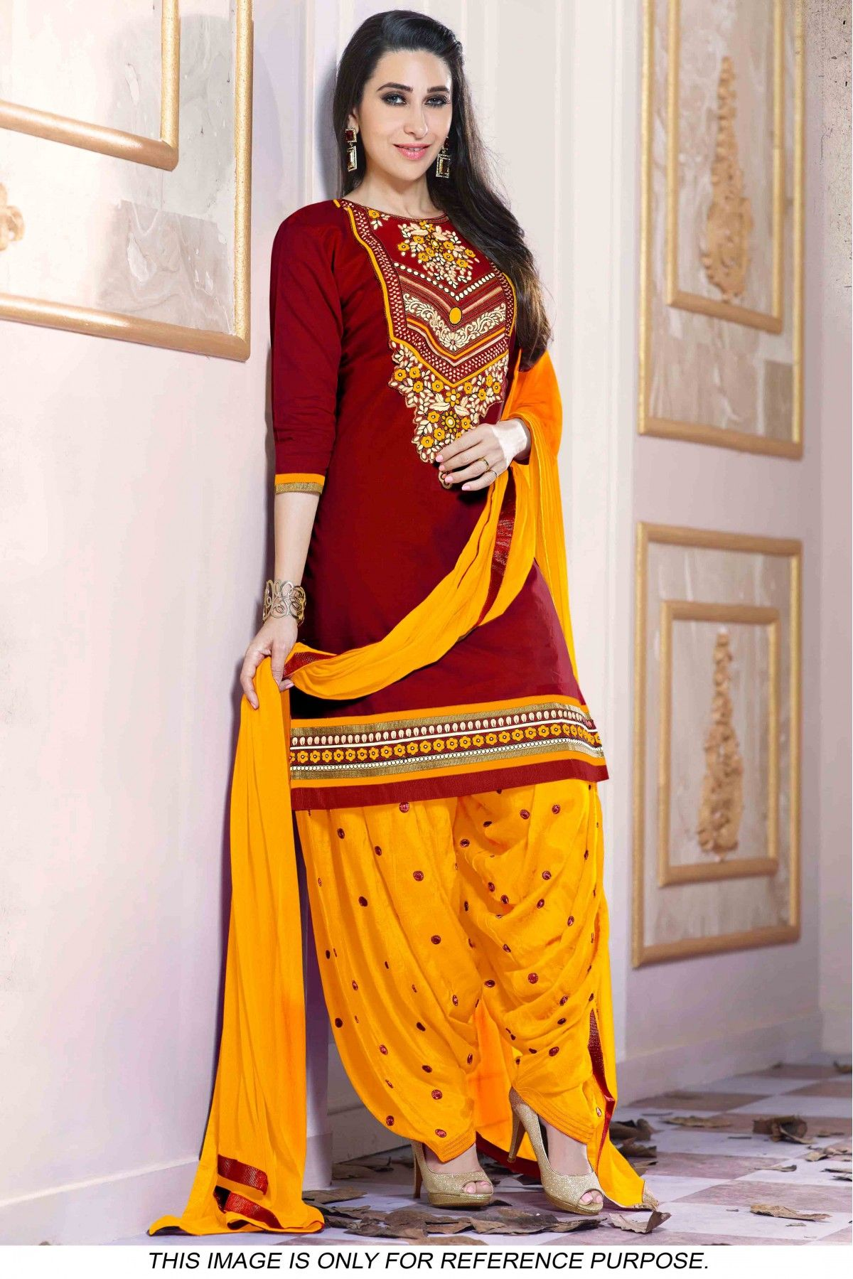 70fe30aa82 Bollywood style Karishma Kapoor Cotton Party Wear Patiala Suit in Maroon  And Yellow Colour .It Comes With Matching Dupatta And Bottom.