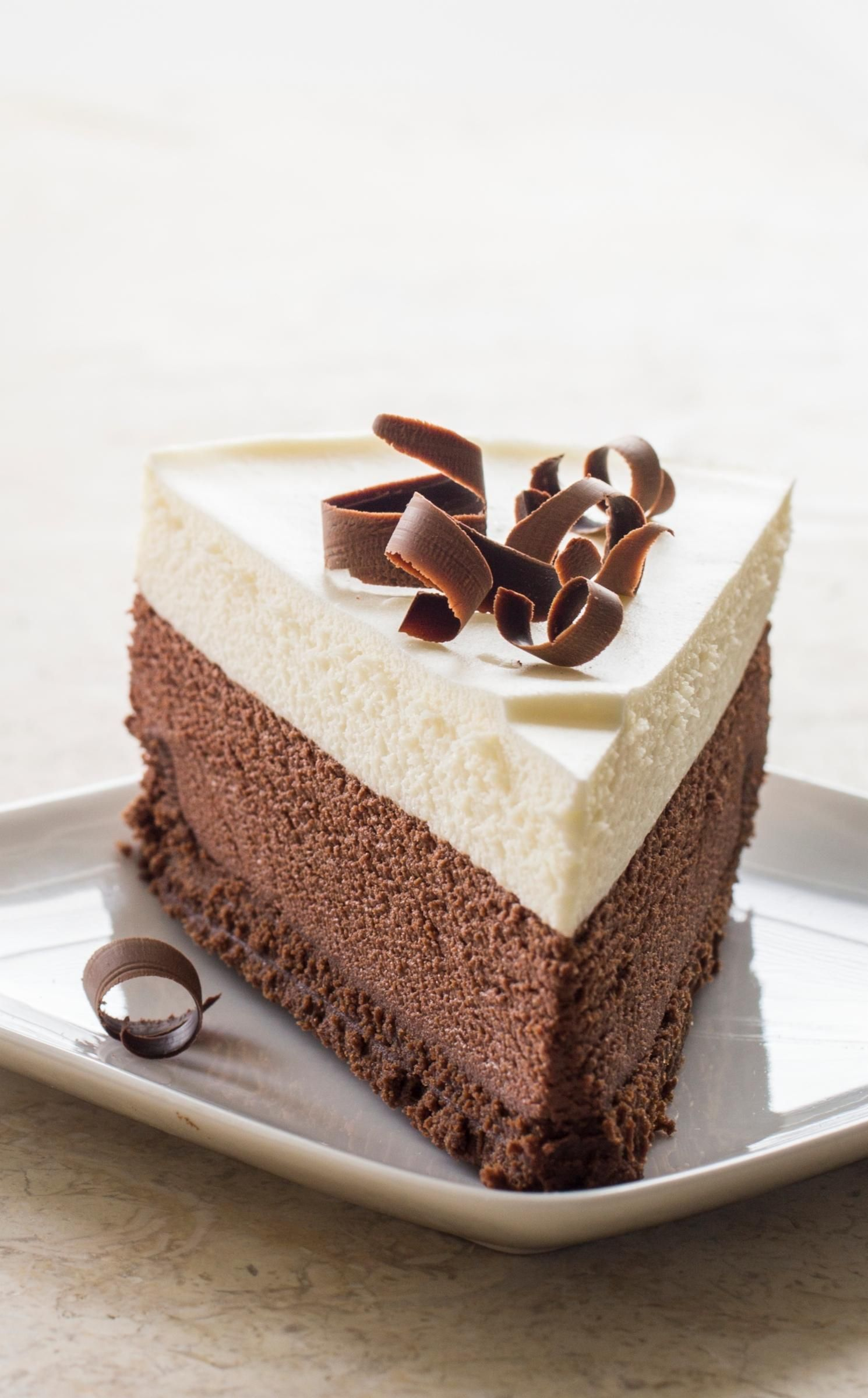 Triple Chocolate Mousse Cake. This triple-decker confection is a ...