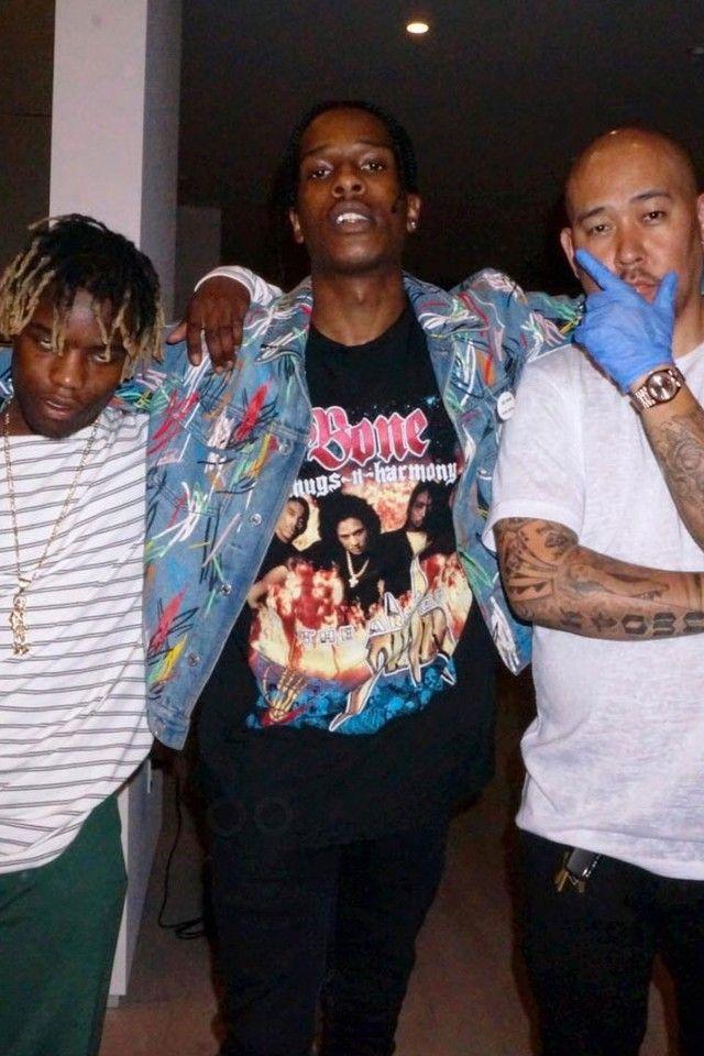 97449939abbc ASAP Rocky wearing Fan Merchandise Vintage Bone Thugs-N-Harmony Look Into  My Eyes Tee, Dior SS15 Homme Jean Jacket