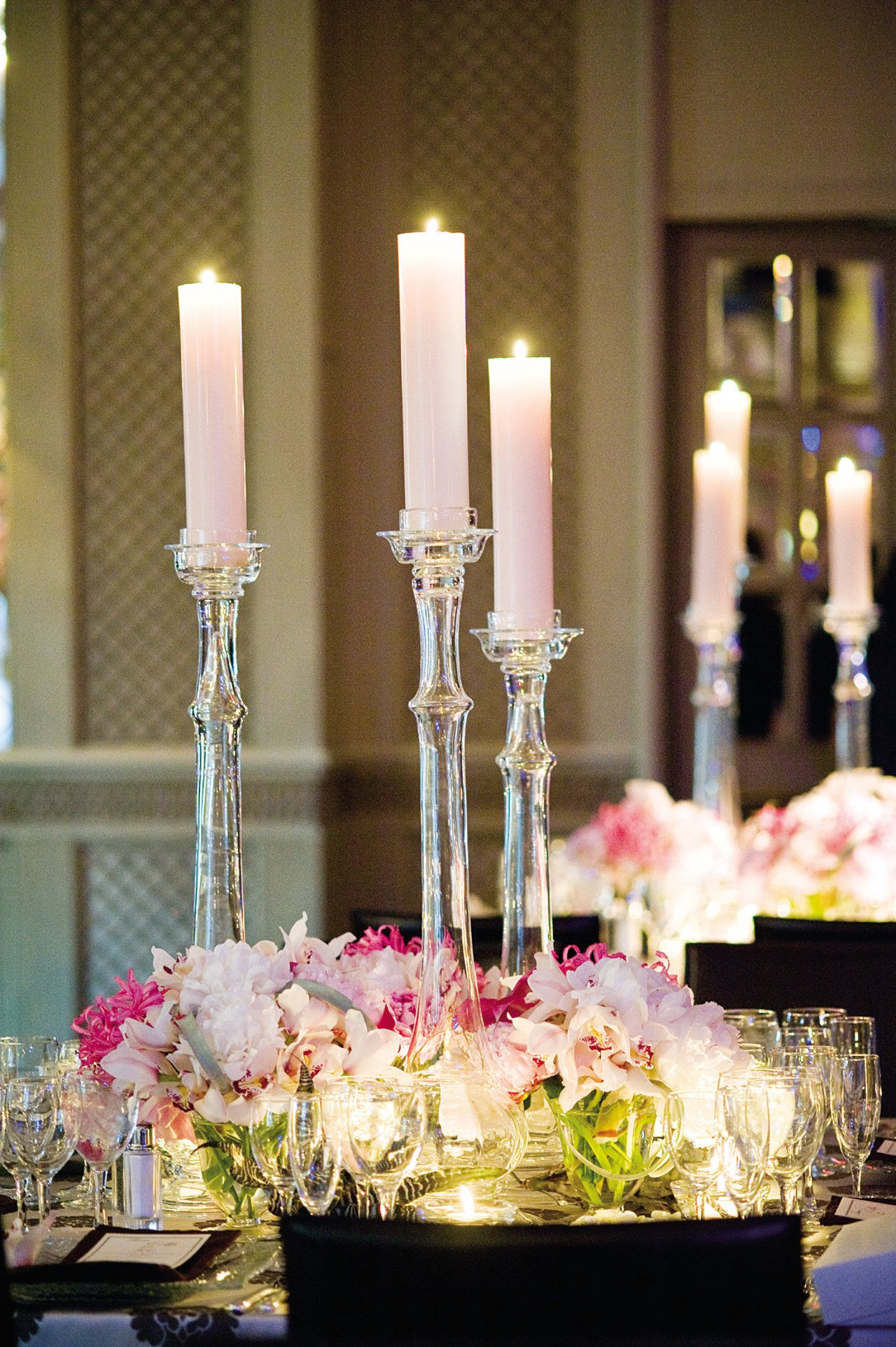 Tall translucent candlesticks add a delightfully modern