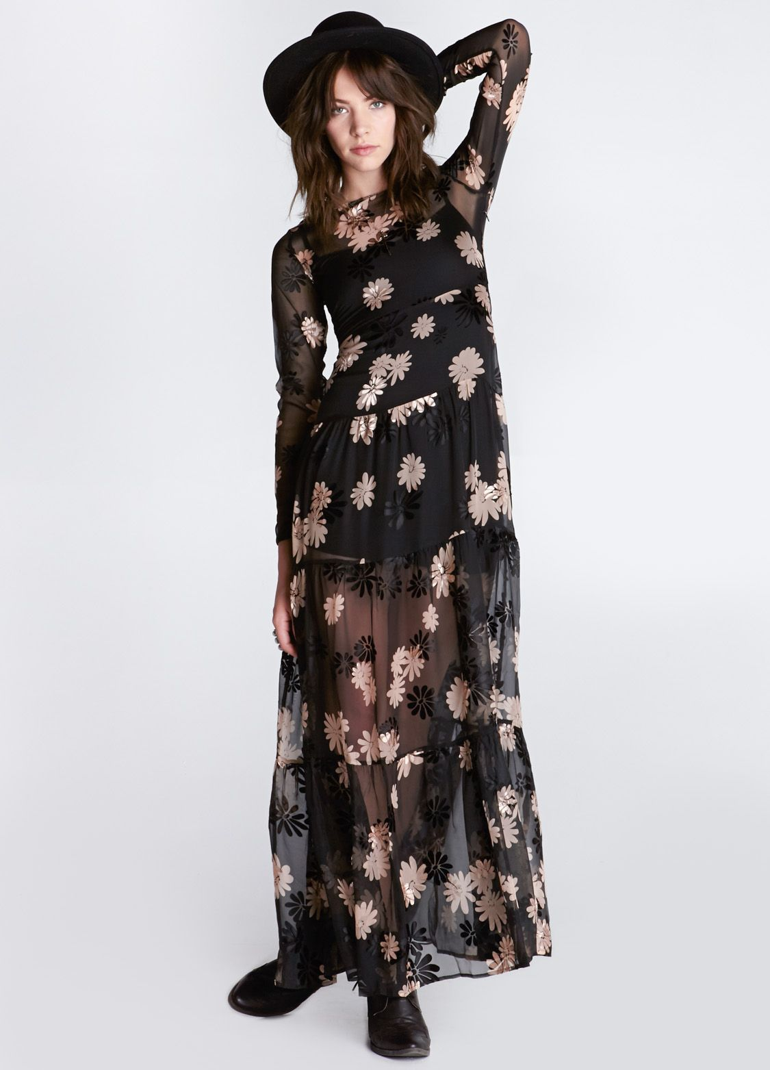 Sheer black maxi dress featuring long sleeves and allover daisy