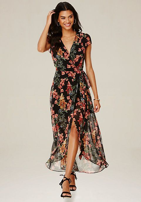 63eef54c4a9c Wedding-guest wrap maxi dress in a pretty bebe-exclusive print. Seductive  plunge neck. Front shoulder tucks and flutter sleeves. Wrap-tie closure.