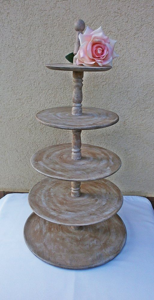 Do you want to ad a rustic element to your wedding or anniversary? Consider this cake, dessert or cupcake display - how sweet! It can fit in perfectly with casual or shabby chic, yet elegant or part of an elaborate decoration on your special day.    Handmade, lathed wood stand with an antiqued treatment to make it look weathered and well lived.