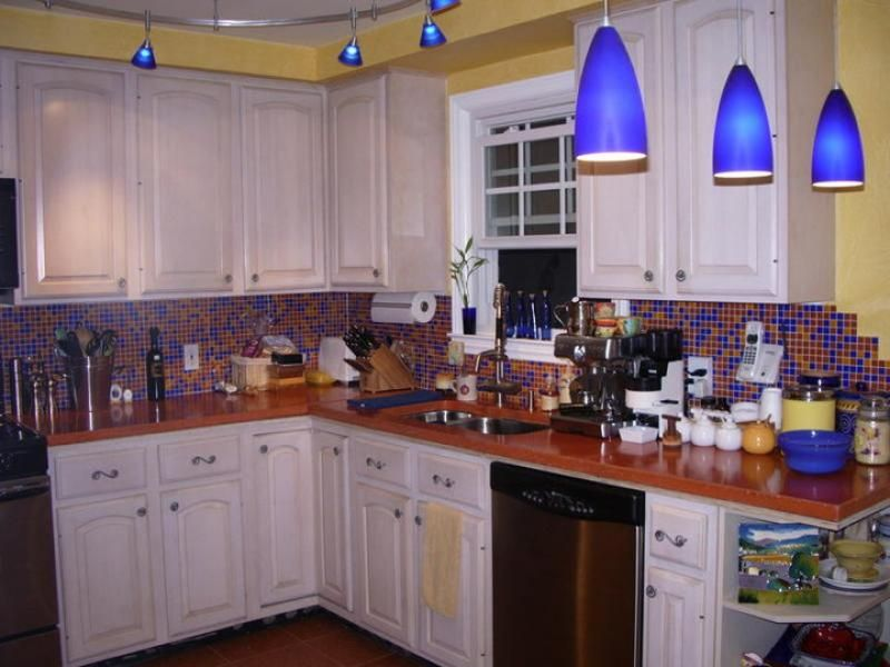 Kitchen Backsplash Yellow Walls when there's too much going on!! yellow walls, blue lights, orange