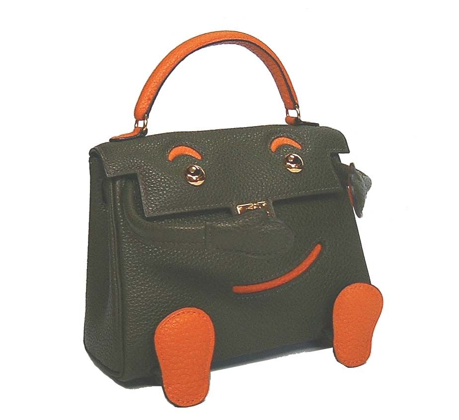 8de8b2fcd #Hermes limited edition Kelly bag with a smiley face and feet! Very cute  though not something I'd carry every day! #purses #handbags #fashion #style
