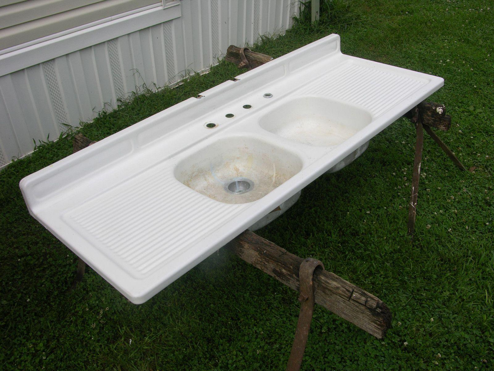 antique farm sink with wash drain areas. LOVE IT. Farm