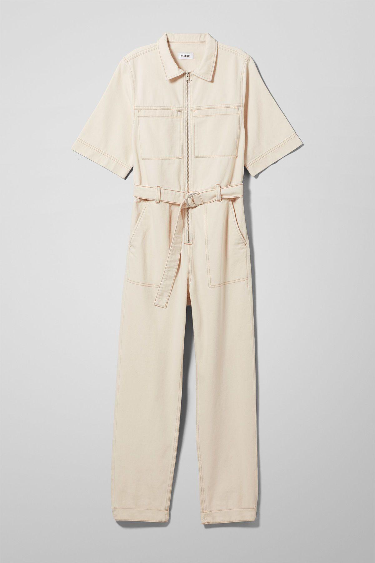 a9eda32850b Petrol Denim Boiler is a workwear-style jumpsuit cut from rigid organic  cotton in ecru. Designed with straight