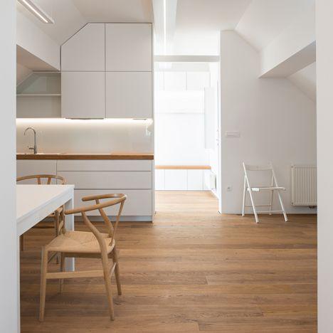 Arhitektura d.o.o. renovates cross-shaped<br /> attic in Slovenia into holiday home