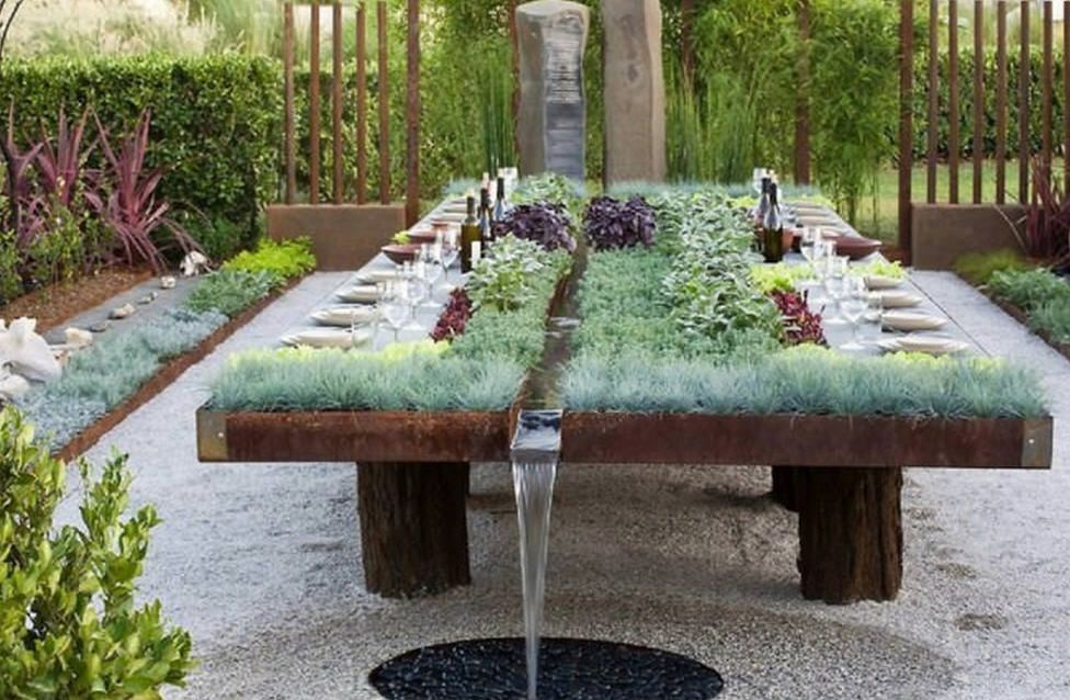 "I thought this ""earth sheltered table"" took it to another level with the water feature."