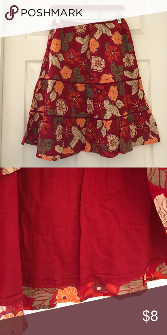 St. John's Bay tiered multicolored Skirt Super cute skirt with dark red background and flowers. Has liner underneath also. Size Medium. In excellent condition. St. John's Bay Skirts Midi