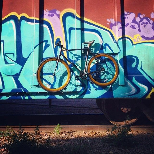 A Pure Fix India against a #Basquiat graffiti mural. #bike #bicycle #fixie #fixedgear #art #streetart #graffiti