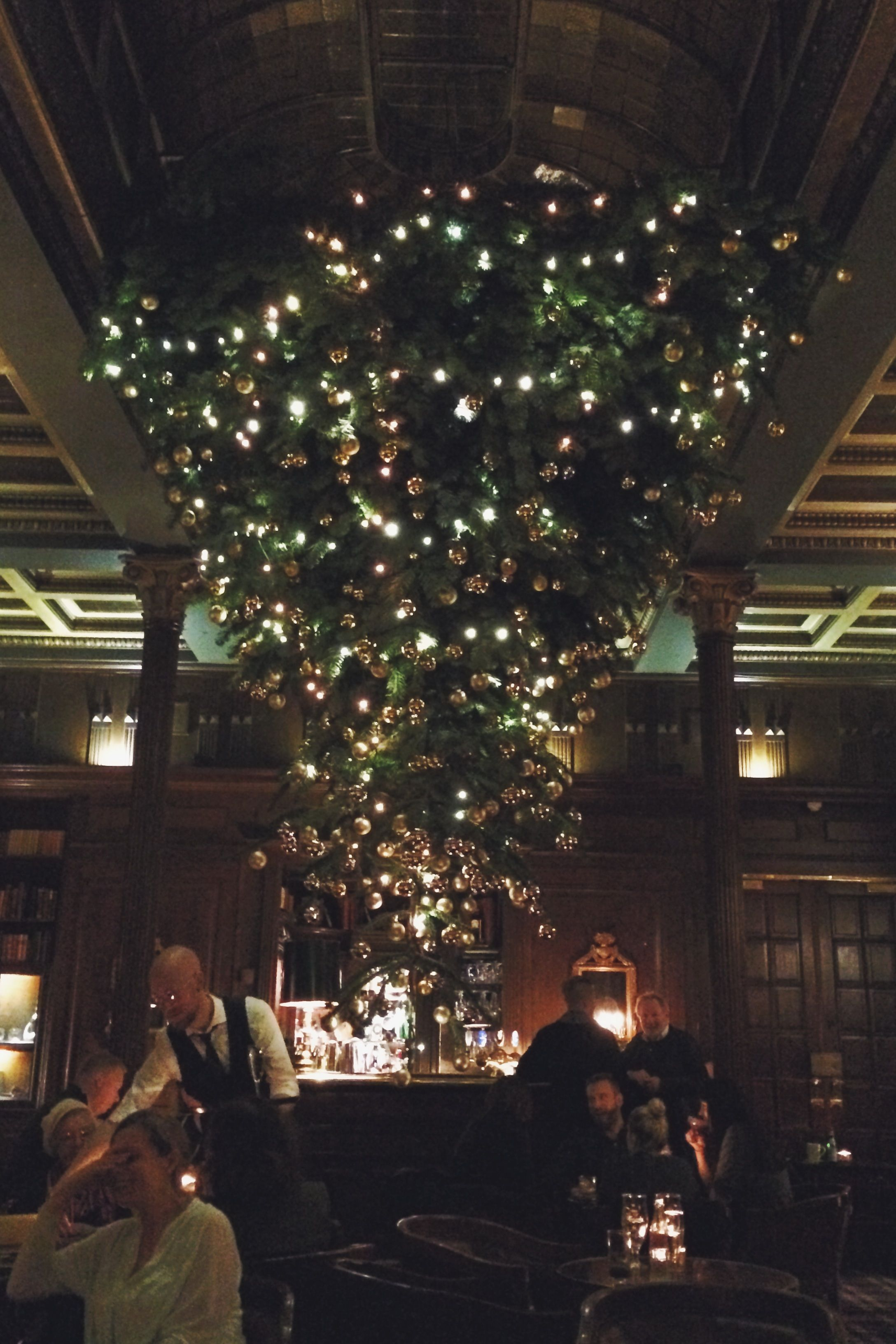 Upside Down Christmas Tree At The Cozy And Stylish Library Bar