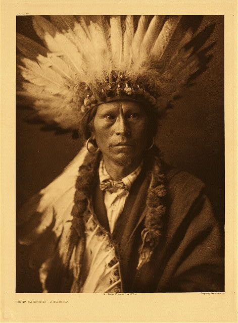 """Chief Garfield - Jicarilla, 1904.  Photogravure.  Curtis Caption:  """"Some years ago the Jicarillas were all officially given Spanish or English names. Many of them expressed a preference. This old man, who was head-chief of the tribe at the time, selected the designation Garfield."""""""