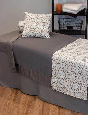The Comphy Company Debuts Grey Table Linen Line Massage Room