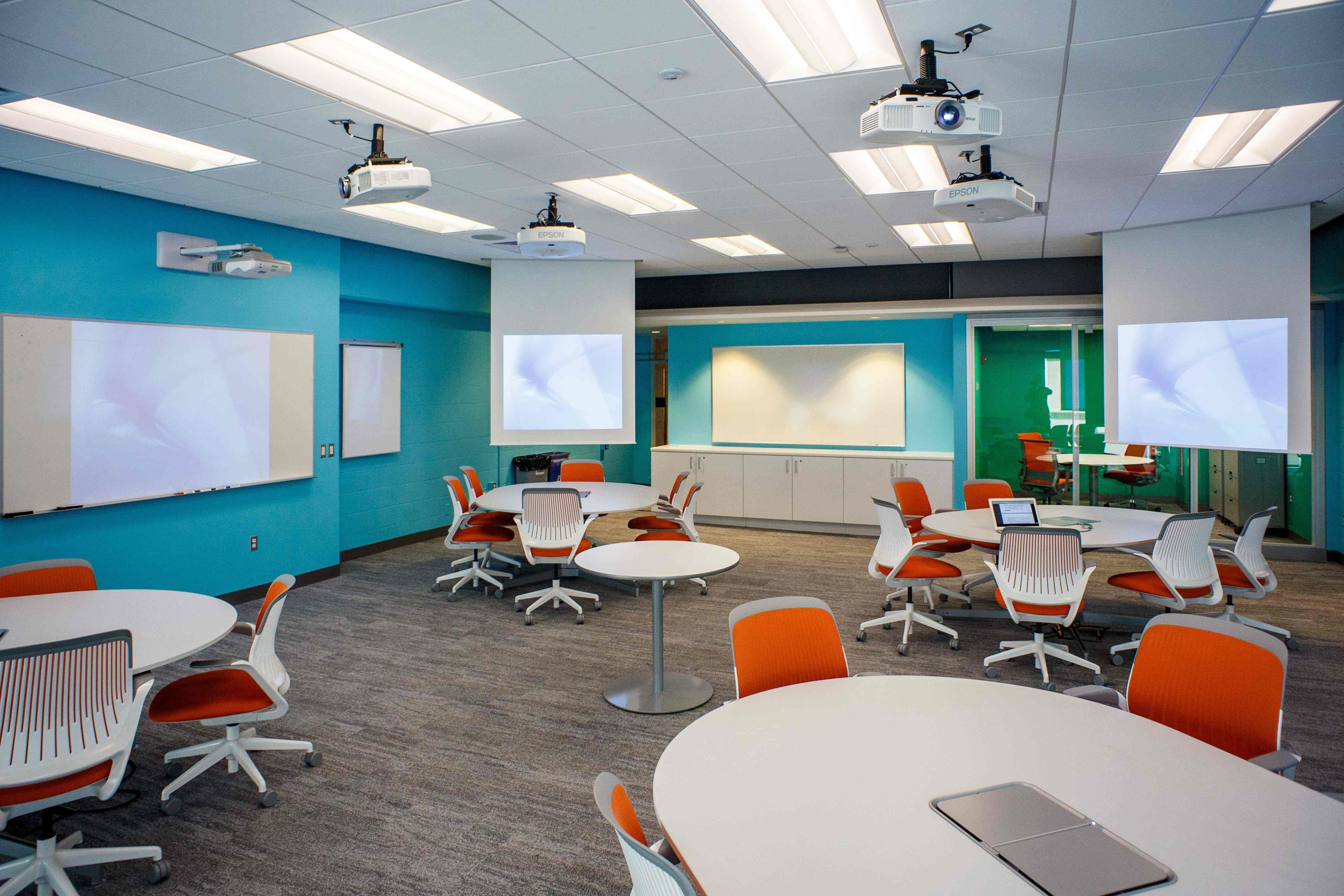 This Learning Space Provides Plenty Of Room And Is Very Warm Inviting With The Many Colors Awesome Lighting Round Tables