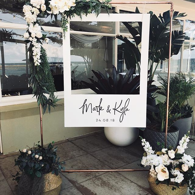 Another beautiful Polaroid photobooth set up! Our copper frame mixed with faux florals from @thefauxfernery a match made in heaven! In its favourite spot at @longreef_weddings