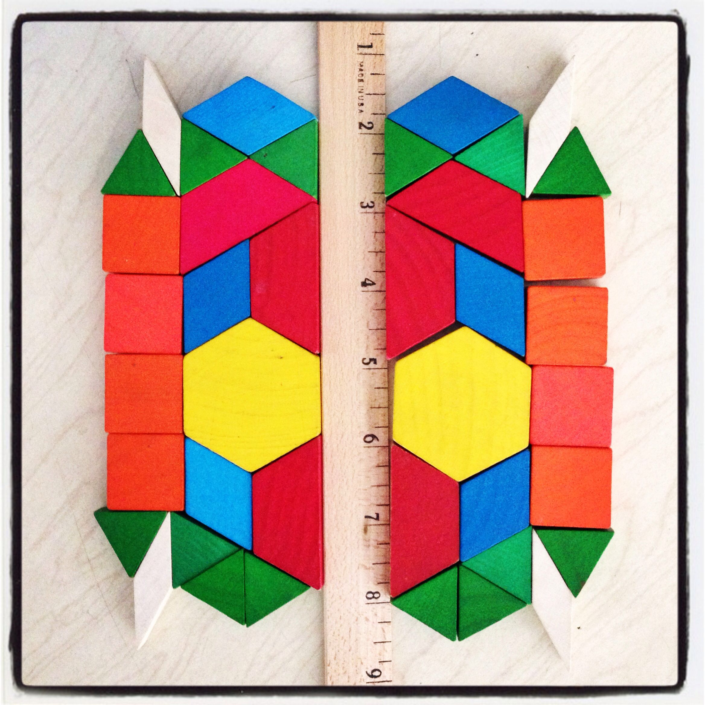 Pattern Blocks Ruler A Naturally Differentiated Way To Let Your Students Demonstrate Their Knowledge Symmetry Activities Symmetry Math Math Learning Center