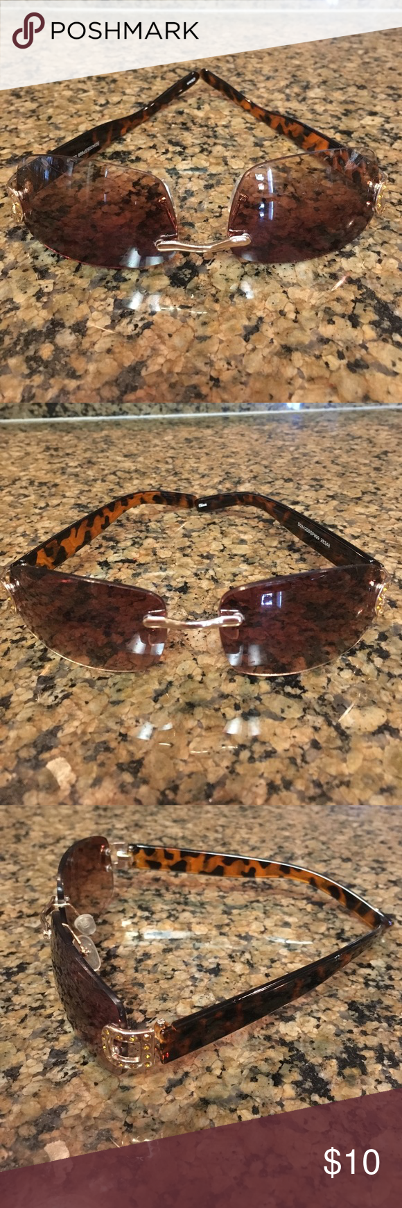 Brownish black sunglasses 😎 Super cute and light brownish/black sunglasses. Has clear nose pads and gold decoration on sides with gold rhinestones. Great condition. Accessories Sunglasses