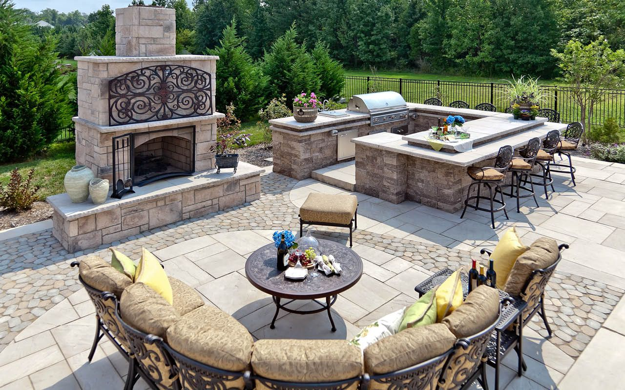this amazing patio include al fresco dining areas  outdoor kitchens  a bar and seating area with