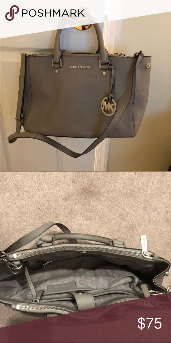 7e7ccec6fd Beautiful gray Michael Kors bag Medium size handbag with shoulder strap.  Small stain on inside fabric. Great condition. Michael Kors Bags Totes