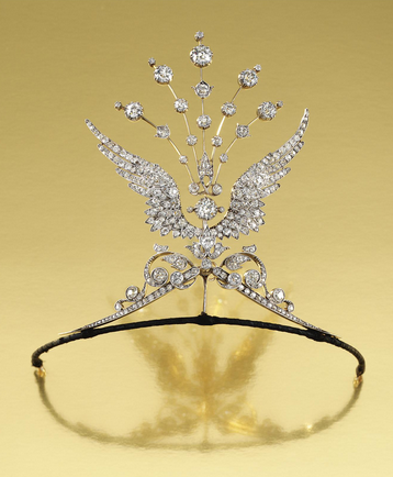 DIAMOND WING AIGRETTE TIARA, 1900S Designed as a pair of opposing scrolls surmounted by two out swept wings terminating in an aigrette of radiating knife-edge bars set throughout with circular-cut diamonds, original fitted case, accompanied by two brooch pin fittings, three tiara frame attachments, a diamond-set suspension bail and a hair pin/aigrette fitting, tiara/aigrette all detachable and may be worn in five combinations, wings detachable for wear as individual brooches.