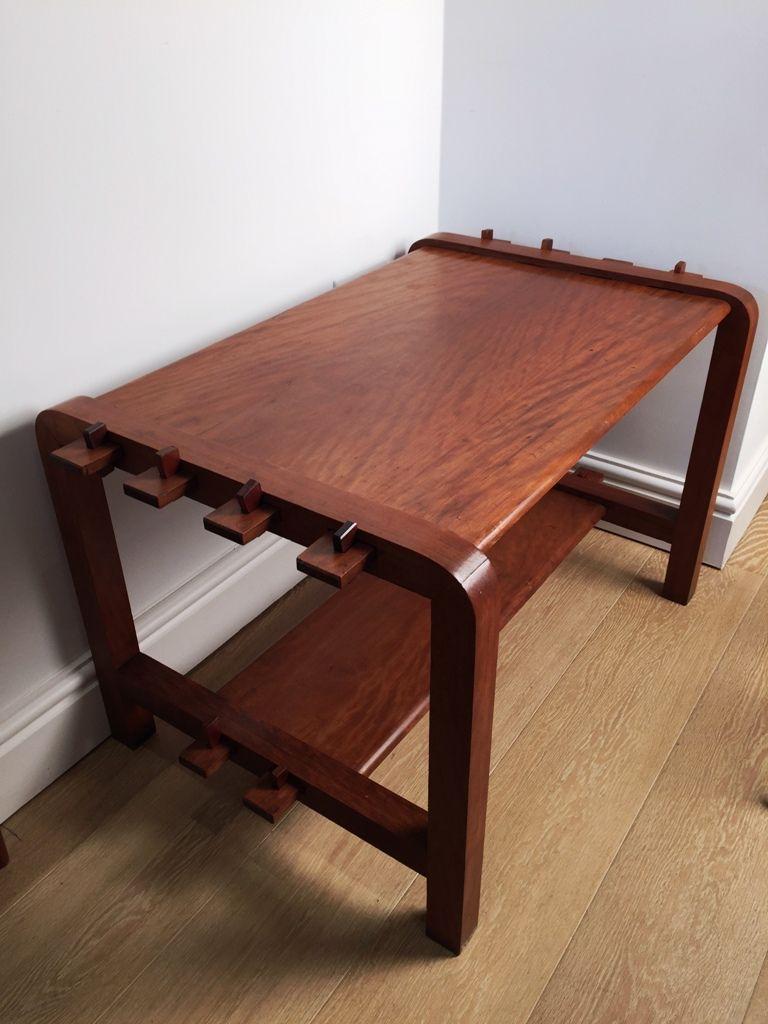 An unusual modernist cherrywood coffee table entirely