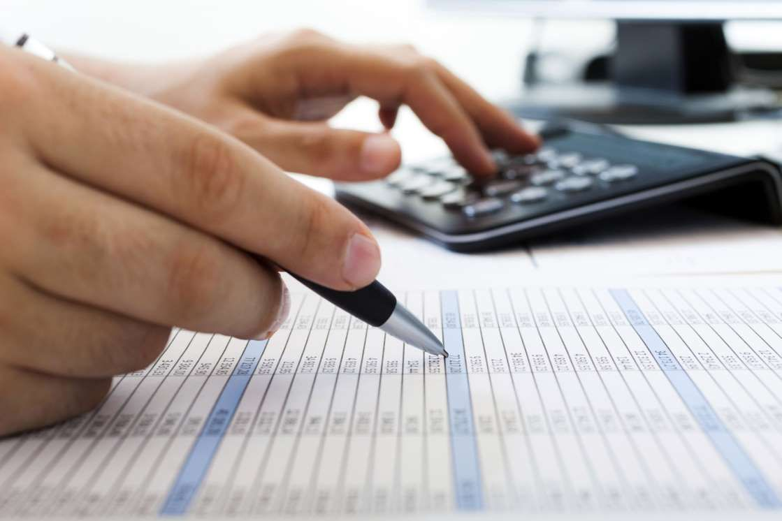 Checking numbers on a table. Making a budget, Budgeting