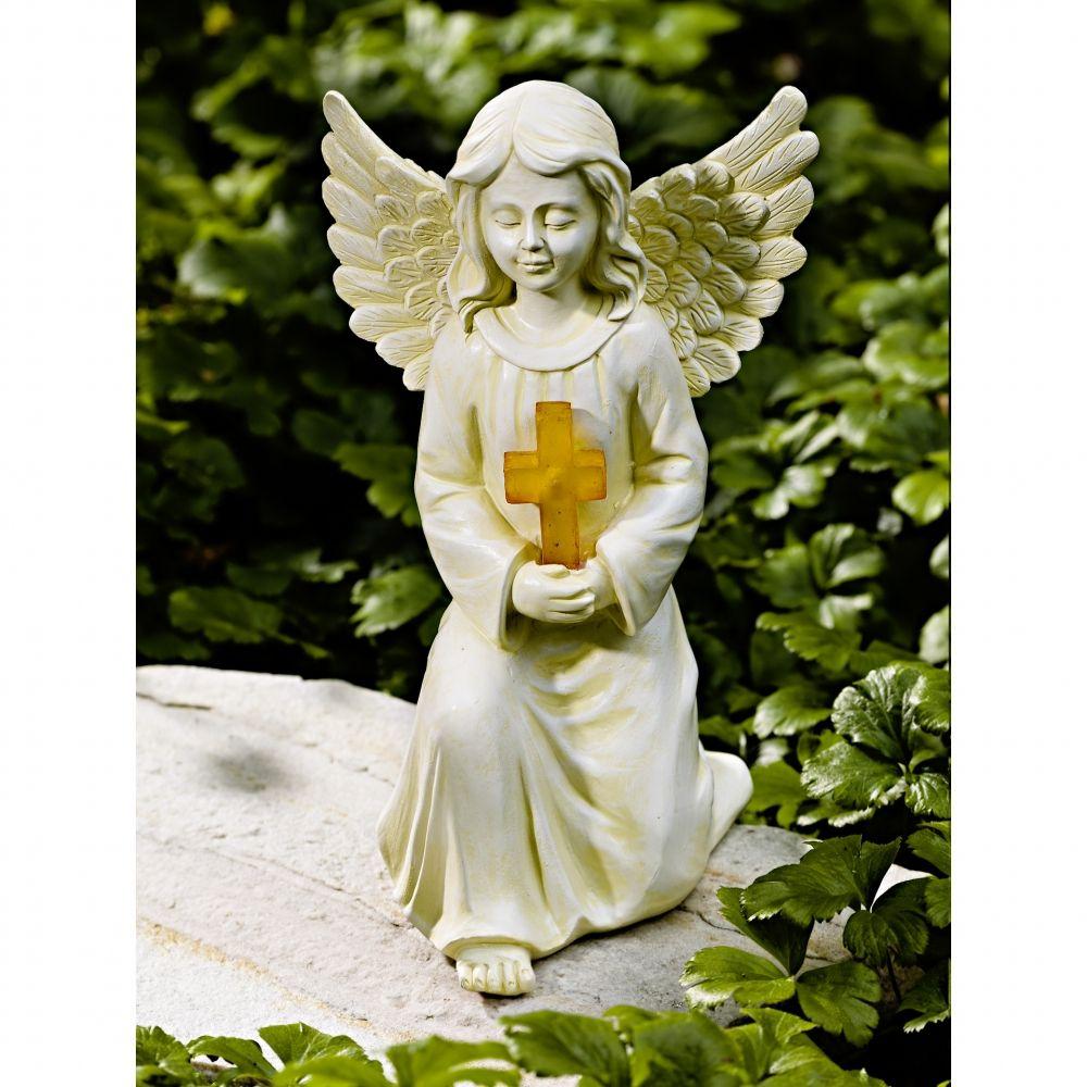 Cette Ravissante Statuette Pour Pierre Tombale Utilise La Lumière Du Jour  Pour Faire Briller Sa Petite Croix Dans Lu0027obscurité. En Polyrésine.