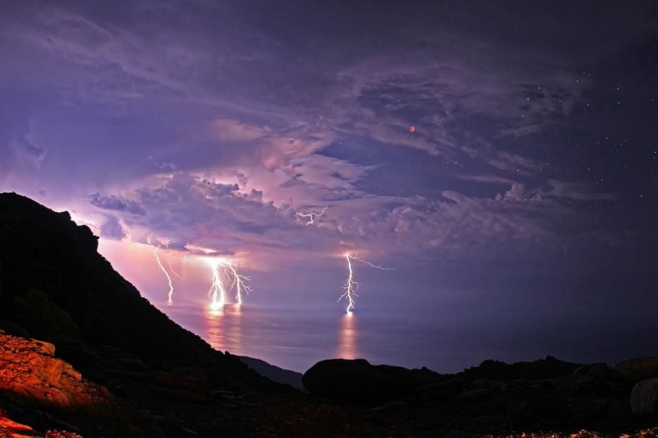 Lightning Eclipse Over Greece - Storm clouds parted during this total eclipse and lightning bolts contributed to the dramatic sky. – på lmage Credit: Chris Kotsiopoulos/GreekSky/NASA (lkaria, Greece - June '11).