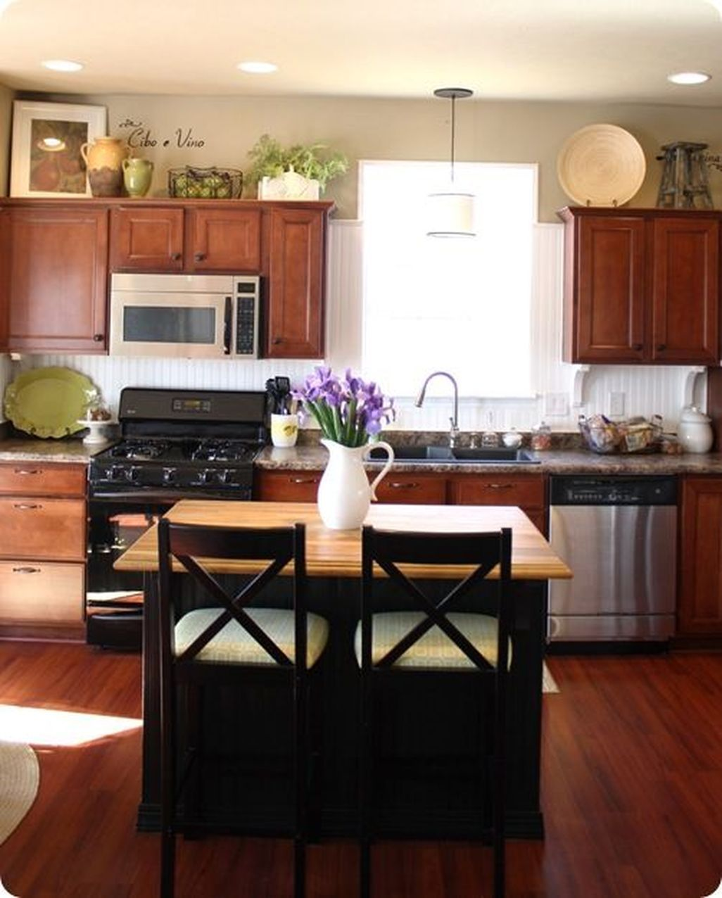 Above cabinet decor Home staging I like the wire basket of ...
