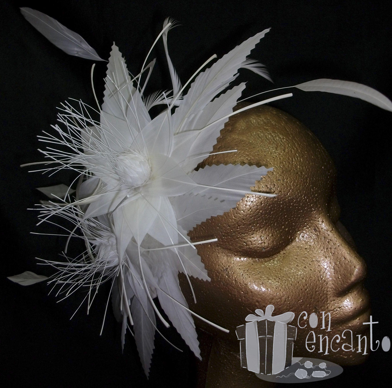 Feather flower fascinator for bridal www.facebook.com/ConEncantoBilbao  Tocado hecho de plumas con dos flores de este mismo material y sobredimensionadas con plumas de ganso trabajadas en su borde con forma sesgada y pluma de diamante que le aporta movimiento