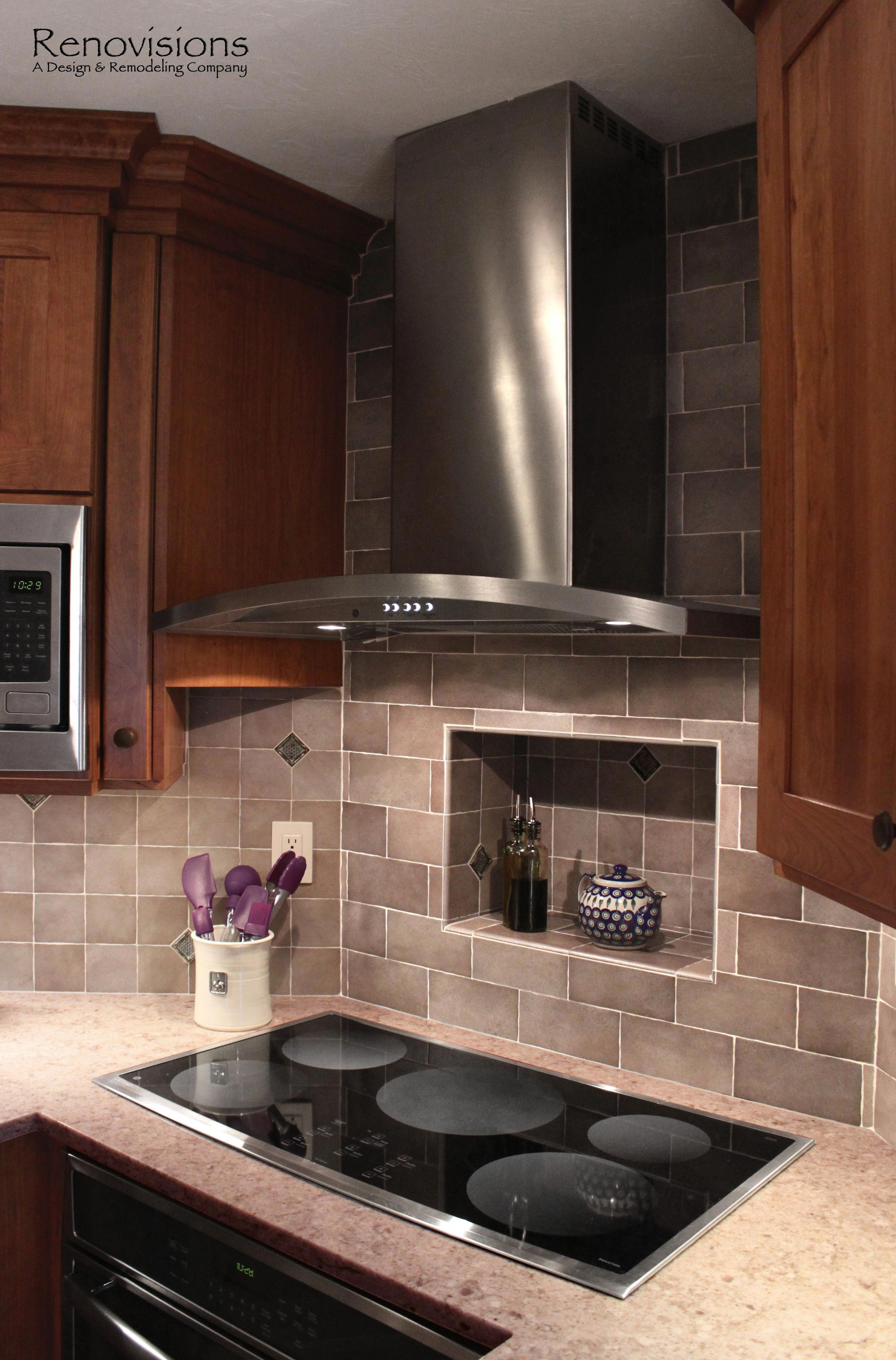 Kitchen remodel by renovisions induction cooktop stainless steel appliances cherry cabinets shaker cabinets under cabinet lights tuscan clay look