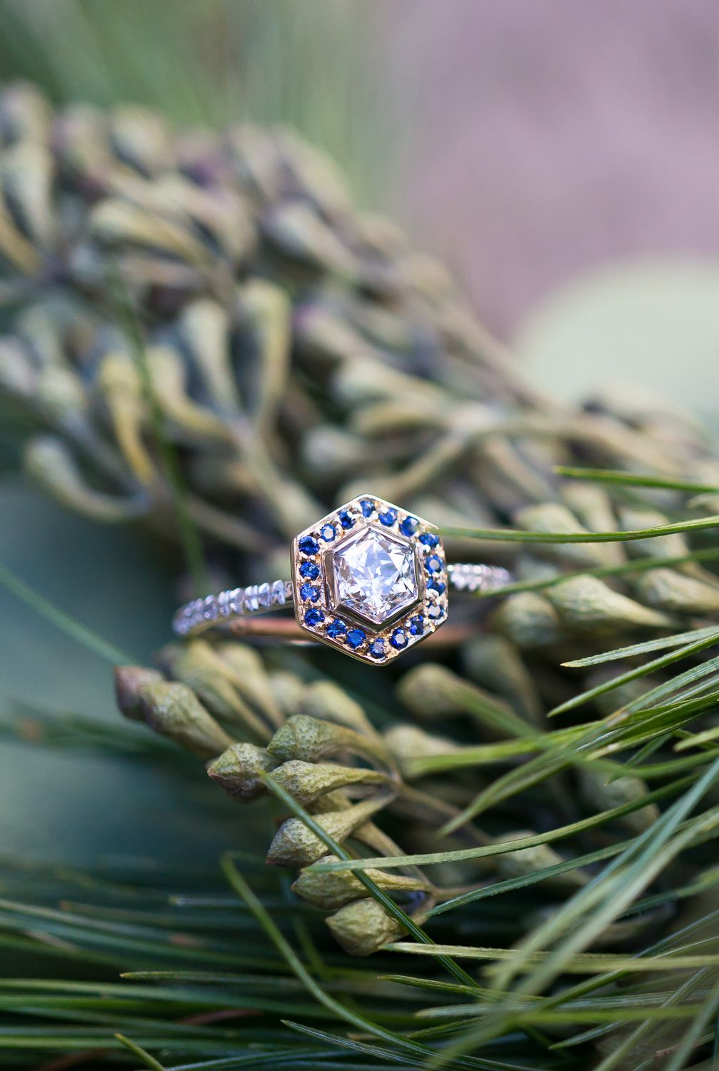 A unique vintage hexagonal Diamond Engagement Ring with a Sapphire Halo handcrafted by S.Kind & Co. in new york.