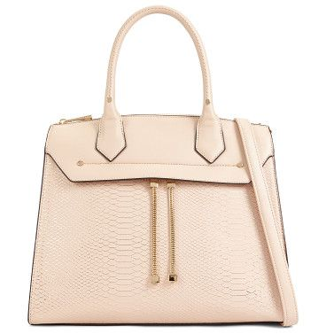a2743755ad93 Craco by ALDO. Delicate gold chain dangles from this structured top handle  bag
