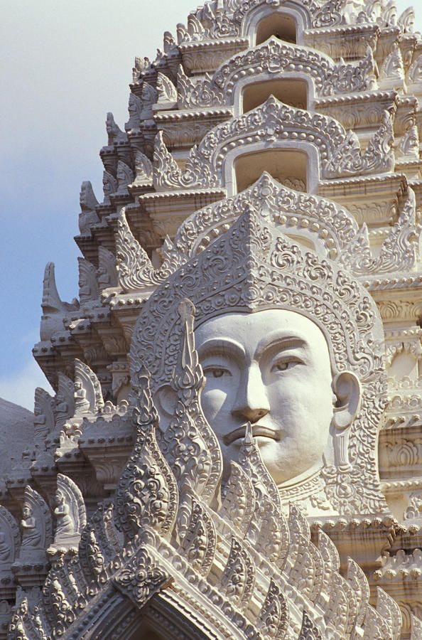 Thailand - Bangkok, Wat Ratchapradt.   Facts about Tailand: Area: 513,115 sq km. A fertile and well-watered land bordering on Myanmar, Laos, Cambodia and Malaysia. Population: 68,139,238. Capital: Bangkok. Official language: Thai. Languages: 85 languages