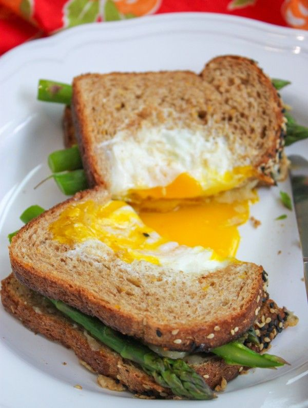 The perfect grilled cheese recipe if there ever was one. Fresh asparagus, gooey Gruyere and then topped off with a fried egg in a basket. Egg in the hole?