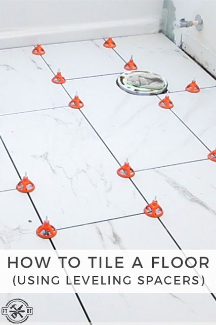 How to tile a bathroom floor.  I replaced the dated tile floor my small bathroom with a custom tile floor.  DIY floor tiling is one of the biggest bangs you can get for your buck.  It totally changes the look and installing large format tiles really makes the room feel bigger.  And using leveling spacers makes working with large tiles a breeze. ***Full Video Tutorial Inside***