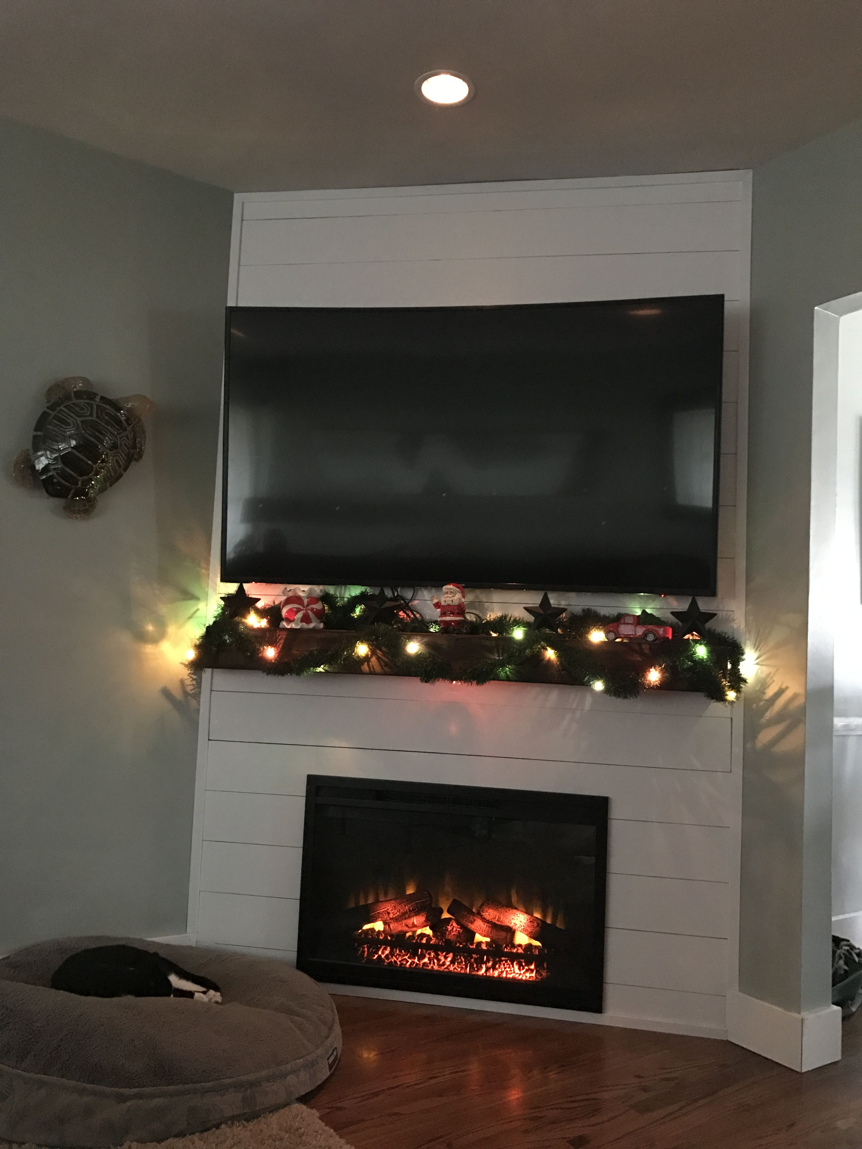 Shiplap corner fireplace with TV above  fireplace in 2019  Farmhouse fireplace Cabin