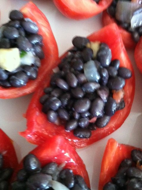 Fresh local tomatoes stuffed with black beans by Soup to Nuts Caterers