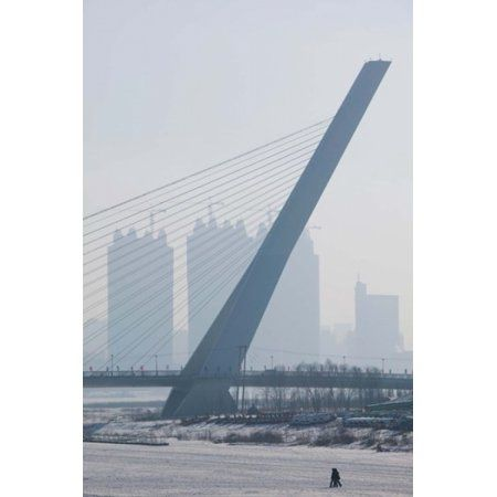 Songhuajiang Highway Bridge across the frozen Songhua River with buildings in the background Harbin China Canvas Art - Panoramic Images (24 x 36)