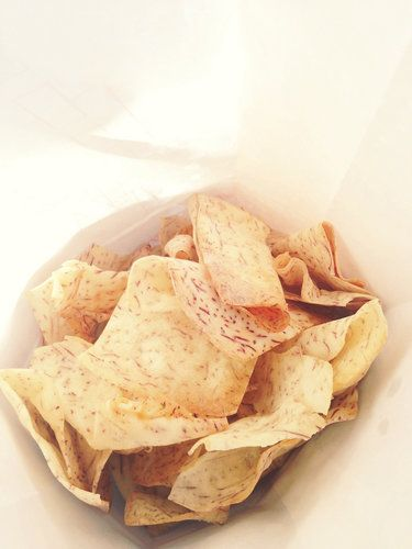 Ditch the Lay's, and opt for these baked taro chips instead. They're lightly dusted with salt and Spanish olive oil to give you the taste you crave without all the calories. Source: Flickr user tinycurrents