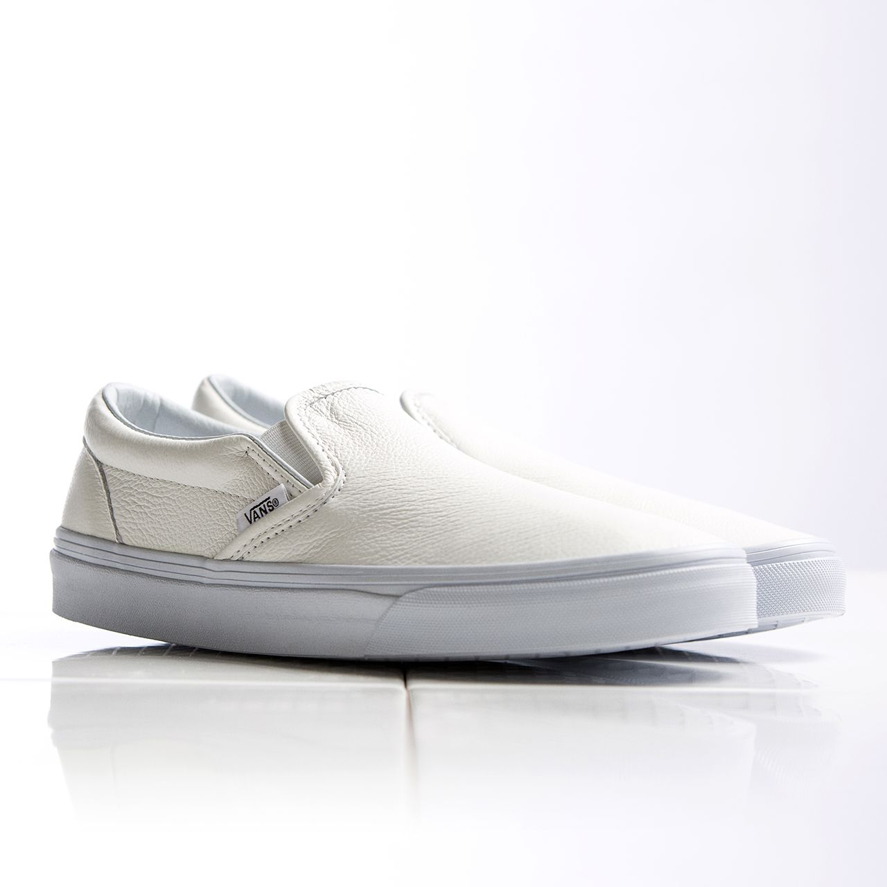 93e0f35d93eb Off The Wall - The Women s Vans Classic Leather Slip On Trainer in White is  now available online   in stores.