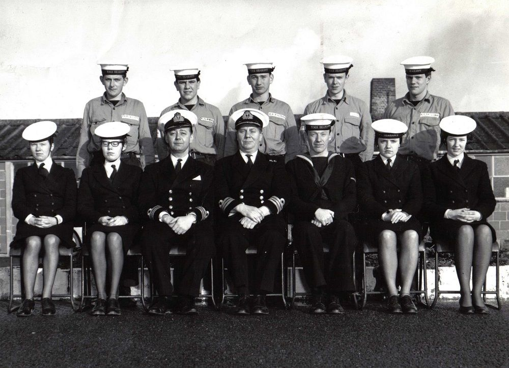 Met Course, RNAS Culdrose (1965)    Back row: Ian Plackett, Anthony Lander, Colin Brenchley, Ioan Evans and Archie Traquair.    Front row: Marie Isles, Jacqueline Boyce, Lt Cdr Ken Cropper, Cdr William Evans, Collis Barker, Elizabeth Milan and Gwyneth Williams.