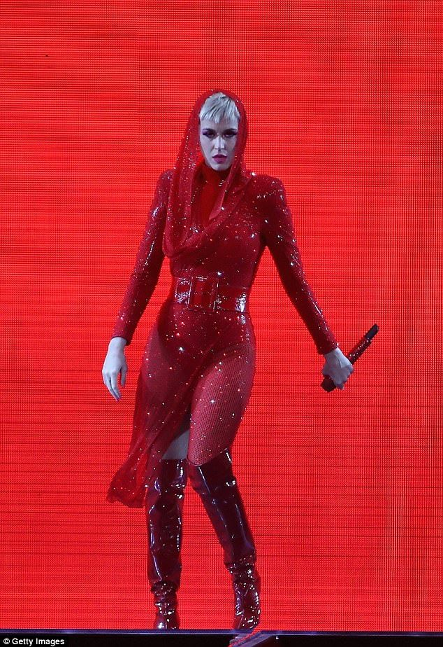 Katy Perry shows off slender frame in red hooded outfit | Katy perry
