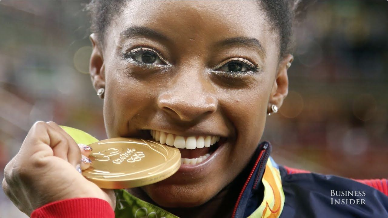 Here's why Olympic athletes bite their medals Simone
