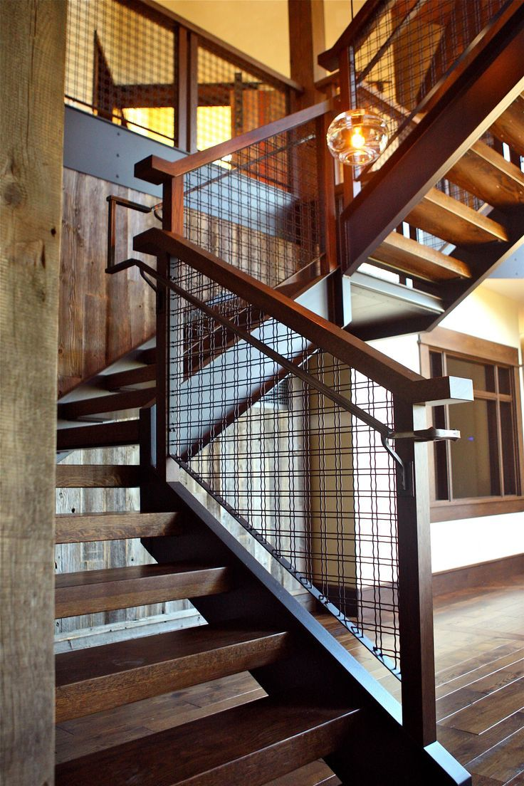 open tread wood stairs with mesh railing Interior