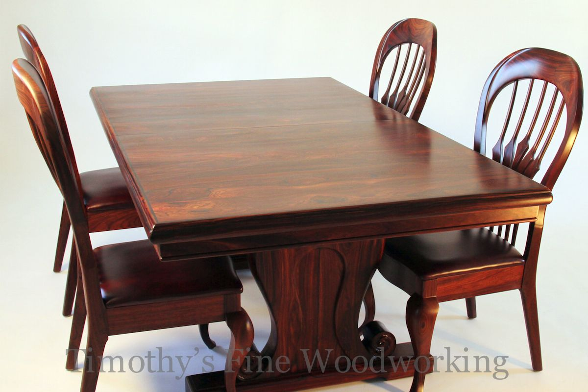 Dining Room Table And Chairs Of Coco Bolo Wood In An Old World